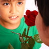 Boy Giving A Rose To His Mother On Mothers Day