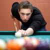 Young Man Shooting Pool