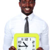 Time is money! Handsome african man holding a clock over white background