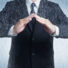 graphicstock-businessman-in-suit-with-two-hands